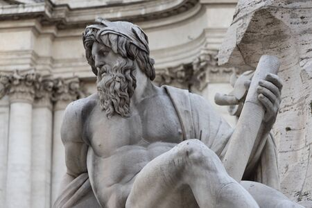 Fountain of the Four Rivers by Gian Lorenzo Bernini, baroque creation located in the center of Piazza Navona, Rome, Italy. Giant white marble statue represents the allegory river Ganges.