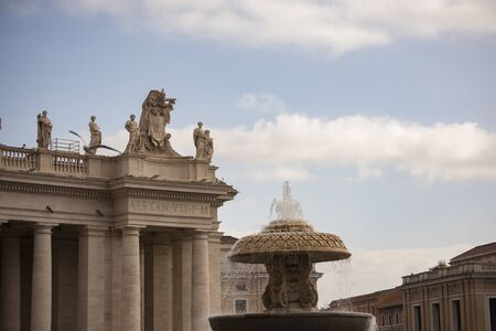 Detail of the facade of St. Peter's Basilica and Bernini's fountain, Rome, Italy. One of the largest buildings in the world since 1600