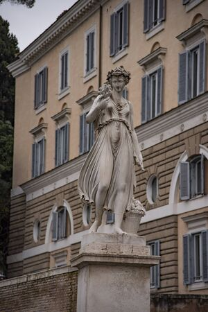 Allegorical statues in summer, Piazza del Popolo in Rome, Italy.