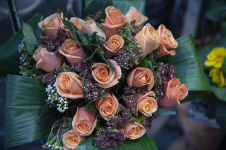 Bunch of pink roses with bridal flowers. Bunch of flowers for brides or holidays.