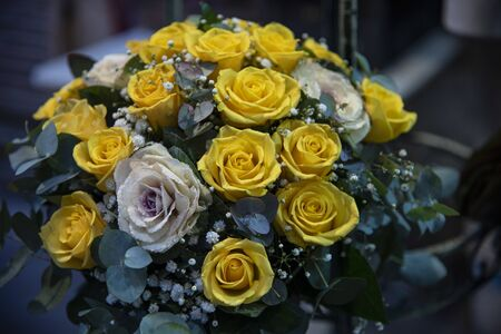 Bouquets of yellow and white roses with bridal flowers. Bunch of flowers for brides or holidays.