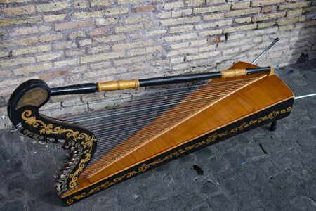 Small street harp. Stringed musical instrument for street player.