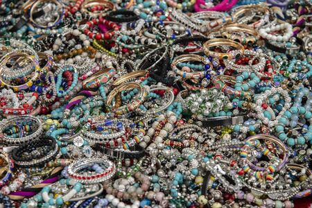 Colorful and inexpensive costume jewelry at the local market in Rome, Italy. Stock fotó