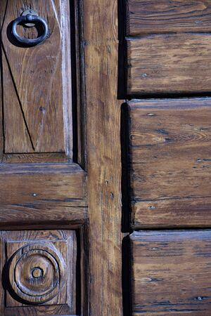 Particular detail of an ancient wooden entrance door of a house in Brescia, Italy. Stock fotó
