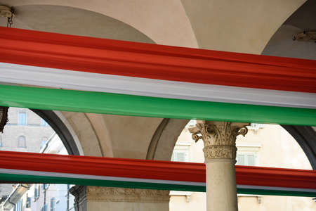 Tricolor flag of the Italian Republic, Brescia, Italy. Palace in Piazza della Loggia, day of the unification of Italy and the armed forces.