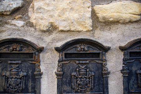 Old original Italian metal mailbox. Vintage object.