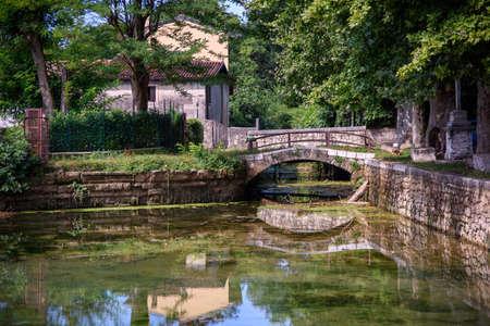 Impressive panorama with an artificial lake with a brick bridge of Roman origin. Archivio Fotografico