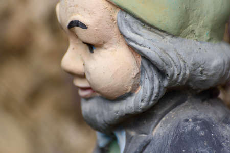 Detail of decorative terracotta dwarf statues for homes. Mountain gnomes.