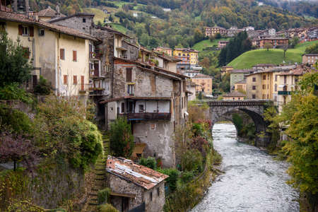 Old houses in San Giovanni Bianco, Bergamo, Italy. Ancient village of Italy. View of the Enna stream.