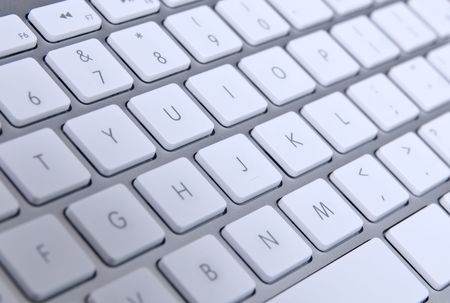 Modern computer keyboard with qwerty close-up photo