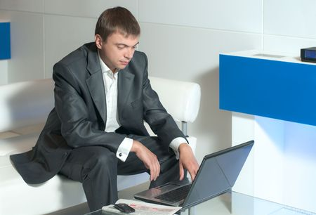conducts: a young businessman conducts business correspondence in the office  Stock Photo