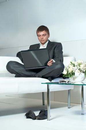 Young businessman relaxing and working at the same time, the work is not a burden