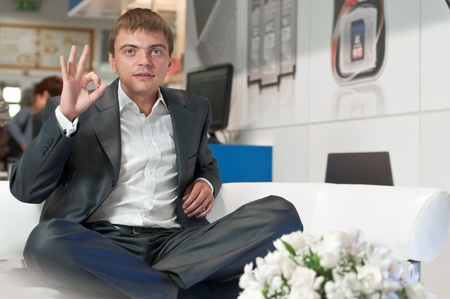 Young successful businessman resting after successful transaction Stock Photo