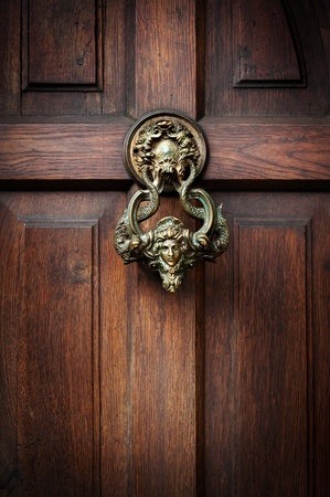 Front door with a handle in the form of the head of Castle Dracula in Transylvania photo