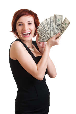 Woman with handful of money, looking pleased with herself on a white background. photo