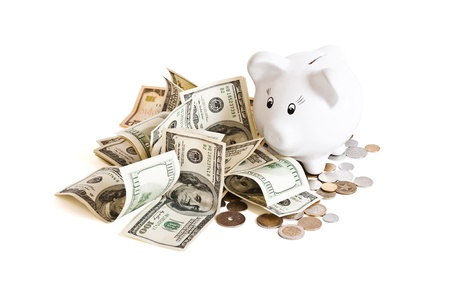pile of money & piggy bank on a white background Stock Photo