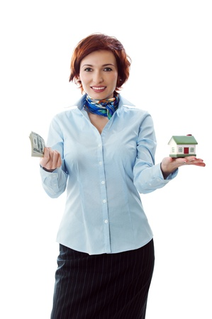 Beautiful young woman holding money and house model over white - real estate loan concept photo