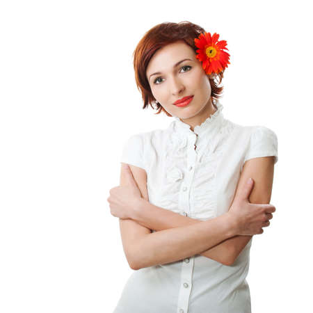 Beautiful woman with flower gerbera against white background photo