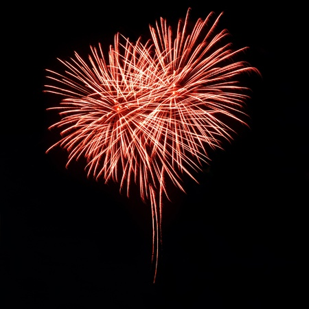 Bright red fireworks in the night sky in the form of heart 스톡 콘텐츠
