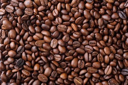 Aromatische koffiebonen in de vorm van natuurlijke achtergrond Stockfoto