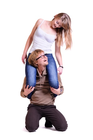 Portrait of young man holding his happy girlfriend on shoulders Stock Photo