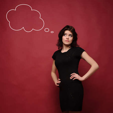 attractive young woman thinking, studio red background