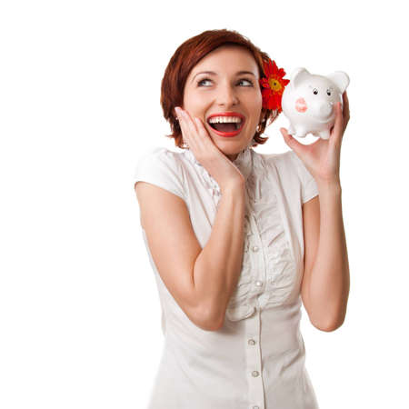 Finance - Woman looking at piggy bank on white background Stock Photo - 12406867