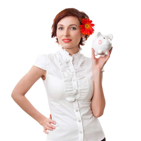 penny pinching: Finance - Woman looking at piggy bank on white background