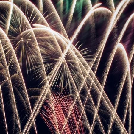 Colorful fireworks over dark sky, displayed during a celebration photo