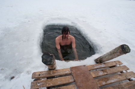 plunge: The winter swimming. man in the ice-hole.