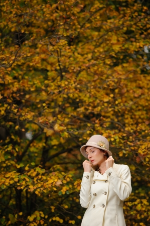 young attractive woman walking in evening autumn park photo