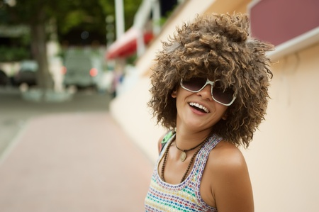 periwig: A beautiful young woman in a wig of curly hair