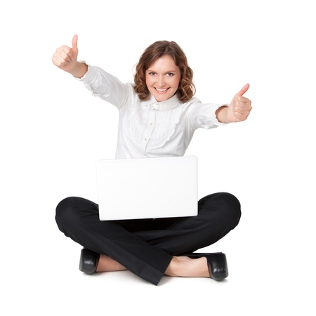 Portrait of a pretty young woman sitting in front of her laptop isolated over a white background Stock Photo - 18201065