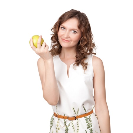 Portrait of an attractive young woman with an apple against white background photo