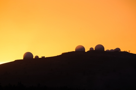 observational: Image of landscapes with silhouette of astronomical observatory at sunset