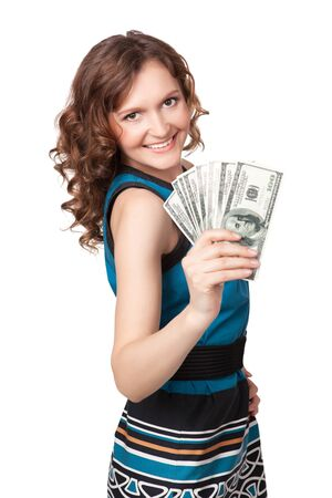 Portrait of pretty young woman holding a fan of dollar bills on white background photo