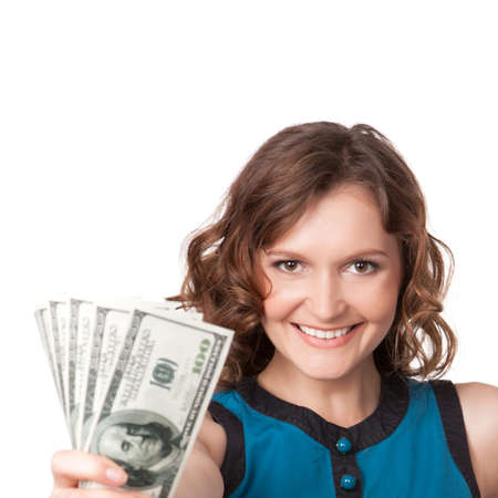 dollar bills: Portrait of pretty young woman holding a fan of dollar bills on white background Stock Photo