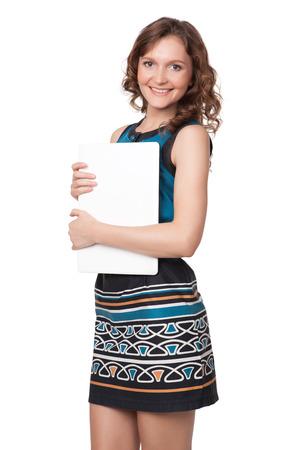 흰색 배경에 노트북과 함께 포즈를 행복 젊은 여자의 초상화