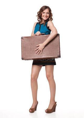 흰색 배경에 가방과 함께 행복 한 젊은 여자