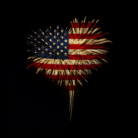 fireworks in a heart shape with the U.S. flag on a black background