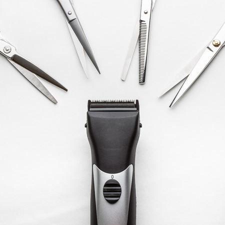 clippers vs scissors on white background photo