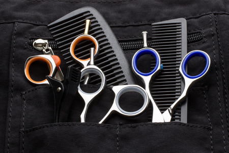 haircutting scissors: professional tools of hairdresser in black case