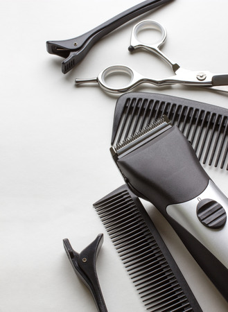 professional tools of hairdresser on white