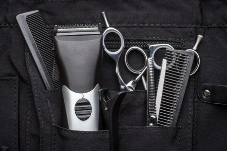 barber scissors: professional tools of hairdresser in black case