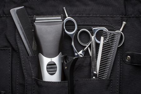 professionele gereedschappen van de kapper in zwarte behuizing Stockfoto