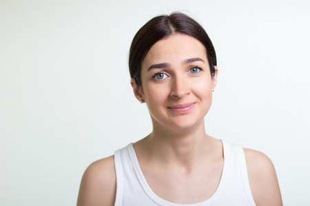 hesitations: portrait of woman about to cry on white background Stock Photo