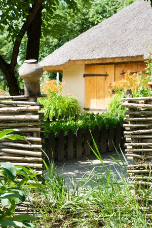 wattled: Old court with wattled fence and shed, covered a straw