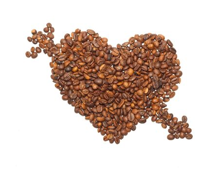 broken through: Heart is broken through an arrow from the corns of coffees isolated on a white background