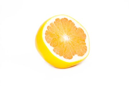 Half of ripe grapefruit  is isolated on a white background Stock Photo - 13713647