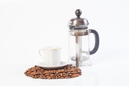 joyfulness: Glass french press, coffee beans and cup isolated on white background Stock Photo